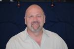 Ken Busche, President